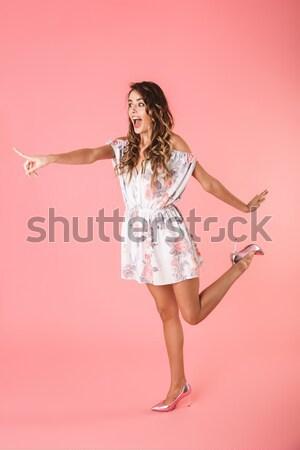 Mosolygó nő fejhallgató tart nyalóka izolált fehér Stock fotó © deandrobot