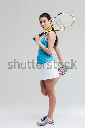 Full length portrait of a happy female tennis player Stock photo © deandrobot