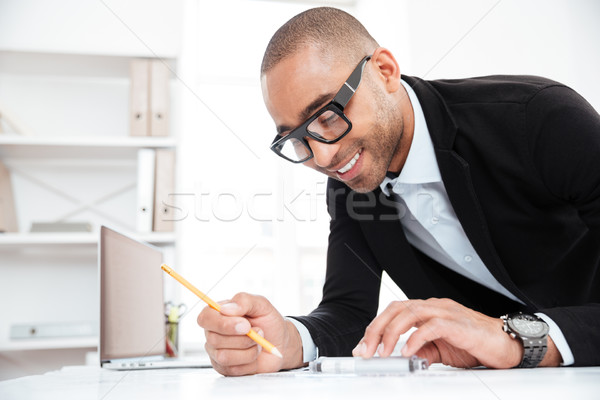 Close-up portrait of a businessman making notes at documents Stock photo © deandrobot