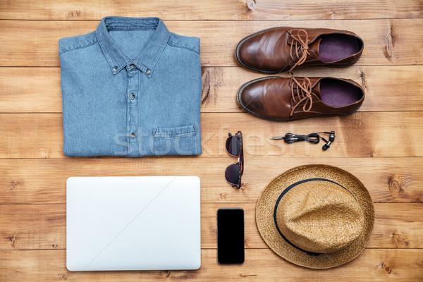 Utazás cipők póló mobiltelefon fülhallgató laptop Stock fotó © deandrobot