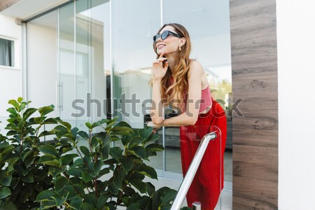 Playful woman reading book and sending kiss in the city Stock photo © deandrobot