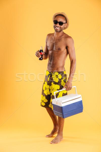 молодым человеком Hat Солнцезащитные очки сумку Сток-фото © deandrobot