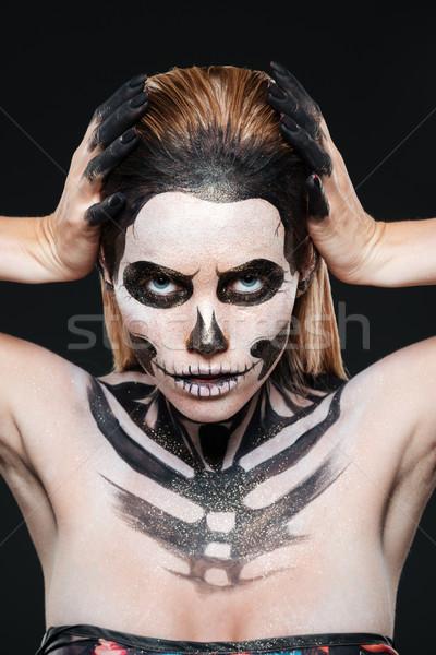 Woman with skeleton halloween makeup Stock photo © deandrobot