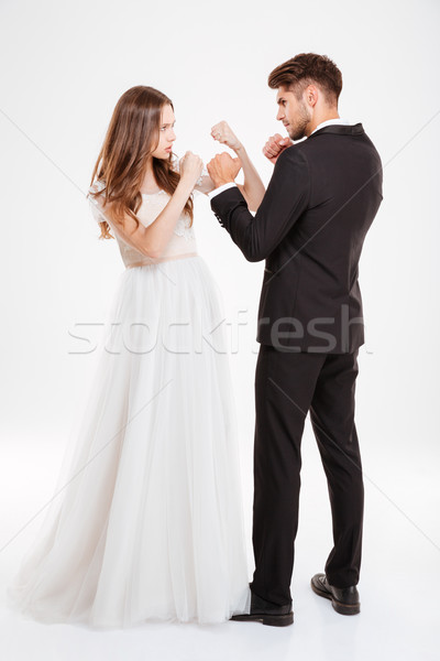 Full lenght portrait of couple fight Stock photo © deandrobot