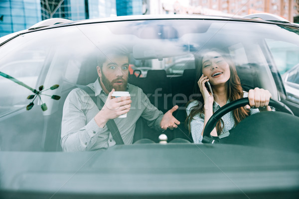 Front portrait of couple in car Stock photo © deandrobot