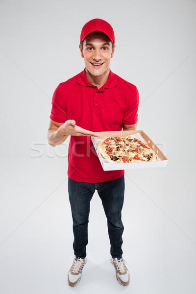 Teljes alakos pizza futár izolált szürke kéz Stock fotó © deandrobot