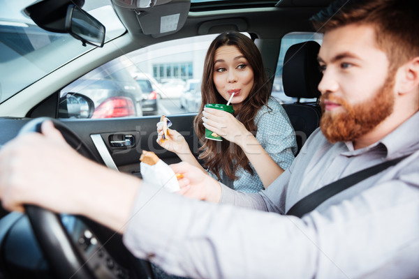 Side view of beauty couple in car Stock photo © deandrobot