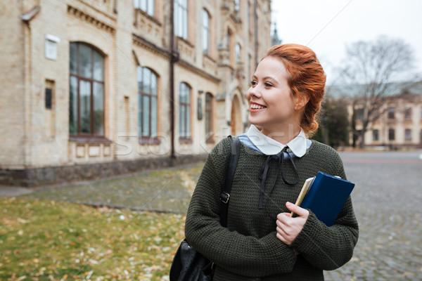 студент книгах Постоянный за пределами университета Сток-фото © deandrobot