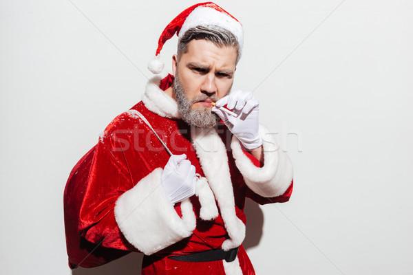 серьезный человека Дед Мороз настоящее мешок Постоянный Сток-фото © deandrobot