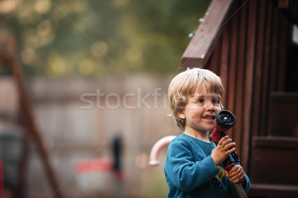 Boy with hose Stock photo © deandrobot