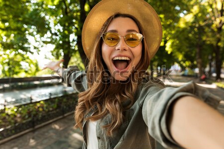 Amazed scared young woman showing stop gesture in the city Stock photo © deandrobot