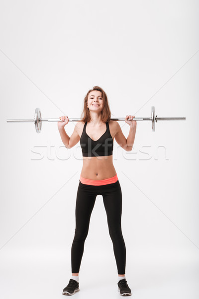 Jeunes fitness dame barbell Photo stock © deandrobot