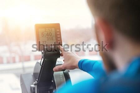 Hátulnézet fotó vonzó fiatal sportoló ül Stock fotó © deandrobot