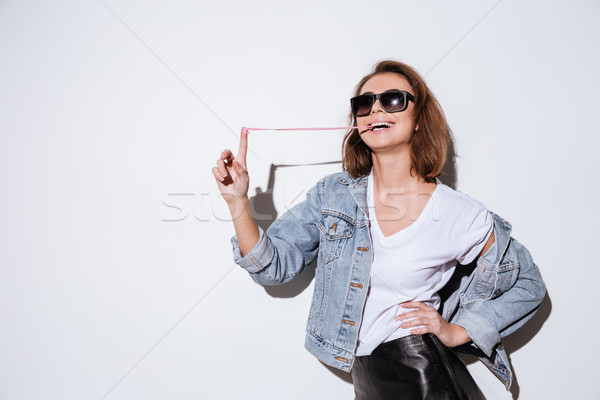 Woman stretching bubble gum. Stock photo © deandrobot