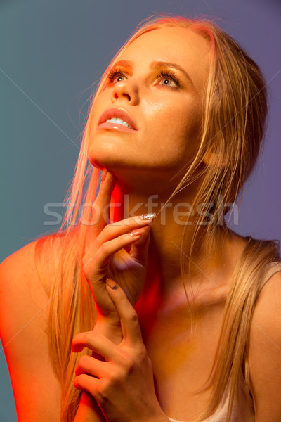 Close up Unusual portrait of woman posing in studio Stock photo © deandrobot