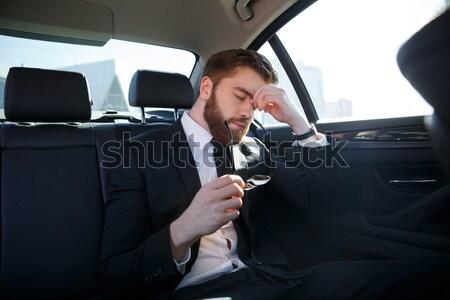 Barbudo empresário falante telefone móvel sessão Foto stock © deandrobot