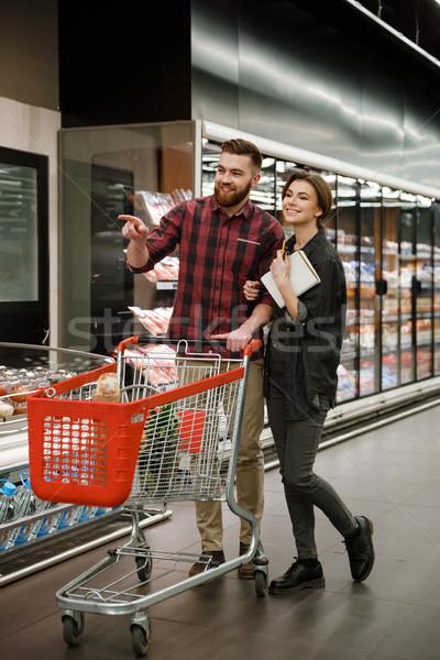 Lächelnd liebevoll Paar Supermarkt Auswahl Produkte Stock foto © deandrobot