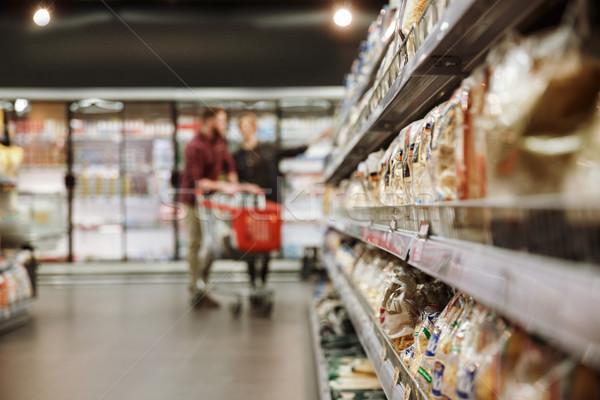 концентрированный молодые любящий пару супермаркета изображение Сток-фото © deandrobot
