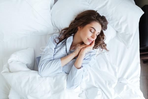 Top jonge mooie vrouw pyjama slapen Stockfoto © deandrobot