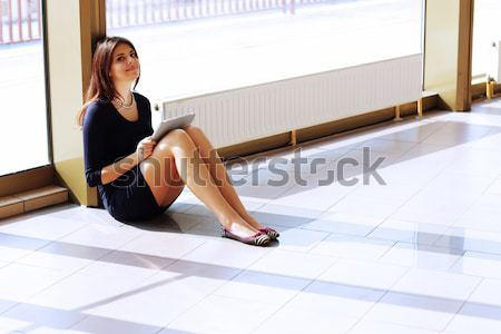 Closeup of barefoot attractive young woman sitting in bathroom Stock photo © deandrobot