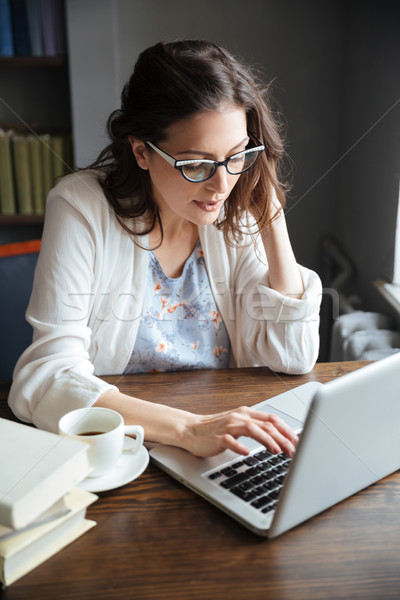 Portrait of a serious attractive mature business woman working Foto stock © deandrobot