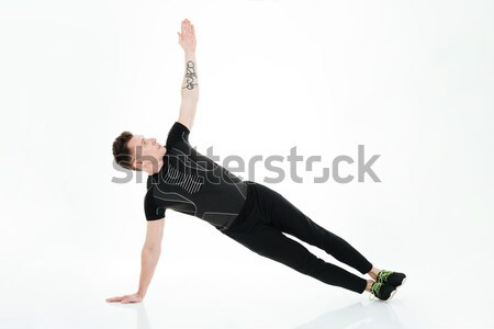 Handsome strong sportsman make sports exercises Stock photo © deandrobot