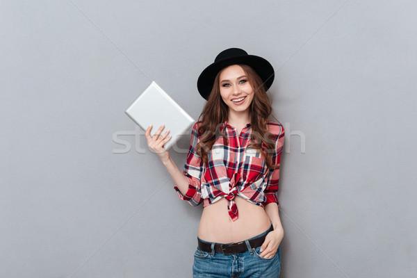 Lezser lány kalap kockás póló tart Stock fotó © deandrobot