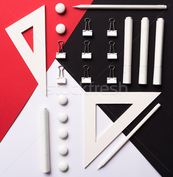 Office supplies on the white red and black background table Stock photo © deandrobot