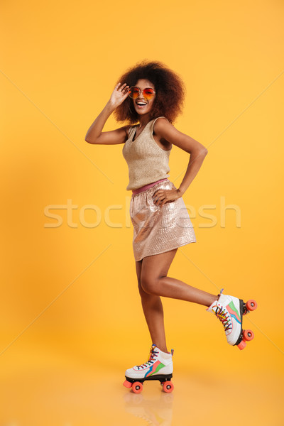Full length portrait of a smiling afro american woman Stock photo © deandrobot