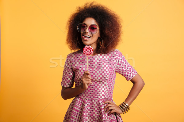 Portrait of a playful afro american woman Stock photo © deandrobot