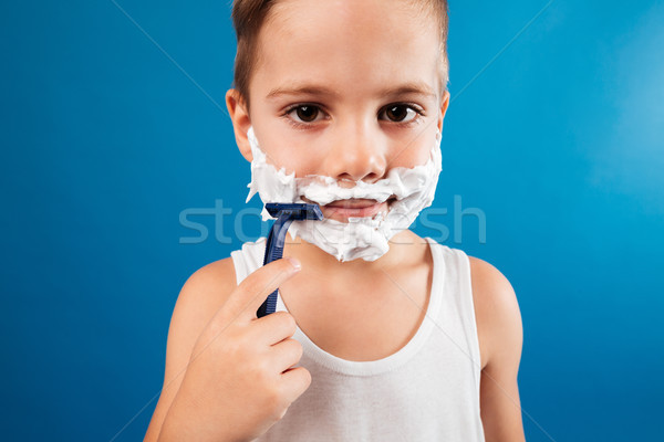 Close up picture of Smiling Young boy trying shaving face Stock photo © deandrobot