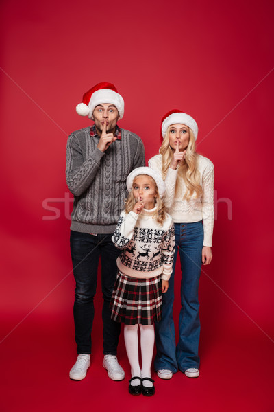 Full length portrait of a beautiful smiling family Stock photo © deandrobot
