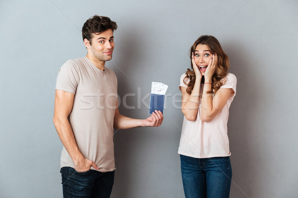 Portrait of a happy man giving to his excited girlfriend Stock photo © deandrobot