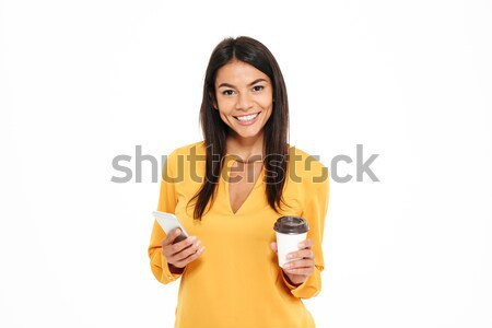 Close-up portrait of happy young brunete woman in yellow shirt h Stock photo © deandrobot