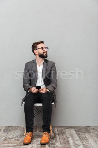 Portret człowiek przypadkowy posiedzenia krzesło Zdjęcia stock © deandrobot