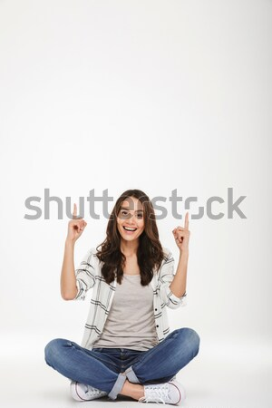 Cheerful young woman showing okay gesture. Stock photo © deandrobot