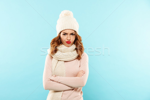 Unhappy displeased lady in blue hat and scarf looking camera isolated Stock photo © deandrobot