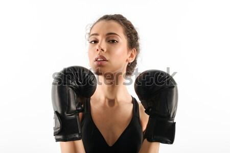 Bastante morena mulher da aptidão luvas de boxe olhando Foto stock © deandrobot