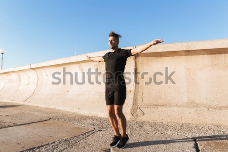 Portrait of a concentrated sportsman jumping Stock photo © deandrobot