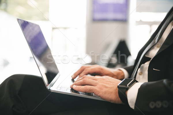 Close up of businessman dressed in suit typing Stock photo © deandrobot