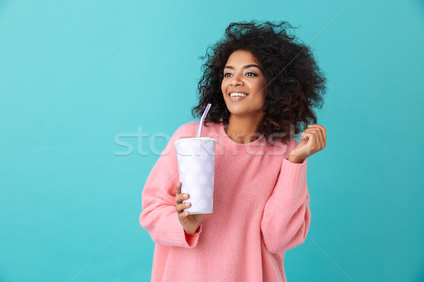 Portrait of adorable woman 20s with afro hairdo looking aside wh Stock photo © deandrobot