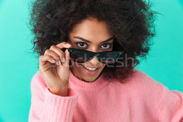 Fashion portrait of young woman 20s with shaggy hair smiling loo Stock photo © deandrobot