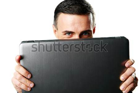 Adam gizleme arkasında dizüstü bilgisayar yalıtılmış beyaz adam Stok fotoğraf © deandrobot