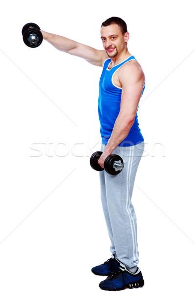 портрет спортивных человека гантели белый стороны Сток-фото © deandrobot