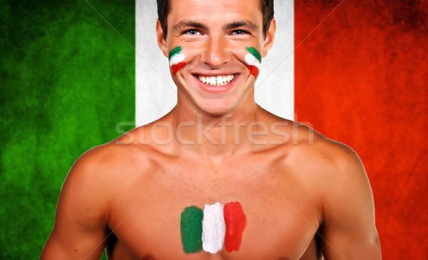 Portrait of an italian soccer fan over italy flag background Stock photo © deandrobot
