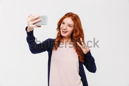 Elegant cute woman making selfie photo Stock photo © deandrobot