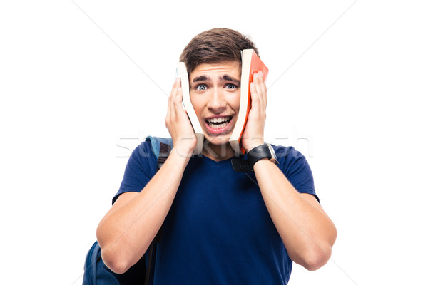 Male student covering his face with books Stock photo © deandrobot