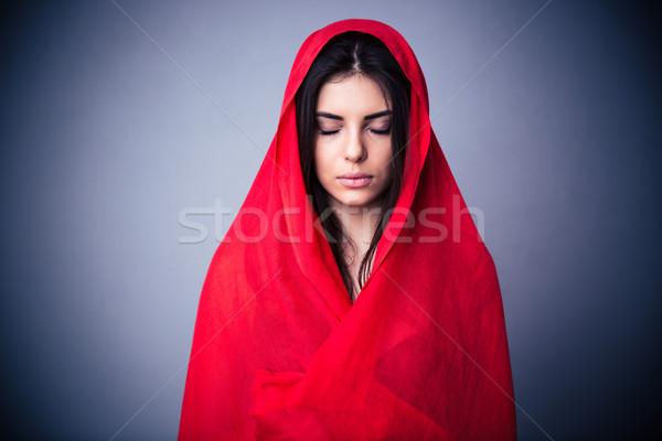 Portré aranyos nő piros ruha csukott szemmel Stock fotó © deandrobot