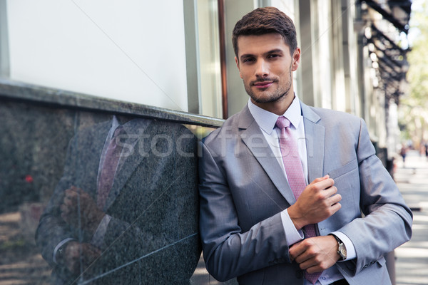 Stock photo: Portrait of a confident businessman outdoors