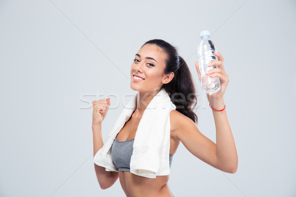 Sports woman holding bottle with water Stock photo © deandrobot